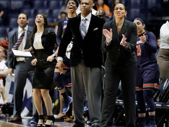 Auburn head coach Terri Williams-Flournoy, front right, applauds after a score against Tennessee in the first half of an NCAA college basketball game at the women's Southeastern Conference tournament Thursday, March 1, 2018, in Nashville, Tenn. (AP Photo/Mark Humphrey)
