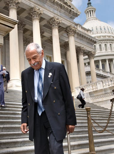 Rep. John Conyers, D-Mich., walks down the steps of the House of Representatives after final votes, at the Capitol in Washington, Friday, May 30, 2014.