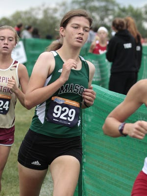 Maegan Murphy of Mason runs at the front of the pack.  Murphy finished in 4th place with a time of 19:07.2.  The 2015 Mason Invitational cross country meet was held Saturday, September 12th at Corwin Nixon Park in Mason.