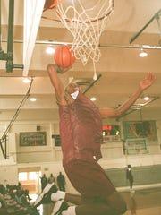 Antwain Ellis rises for a dunk during a Lanier practice
