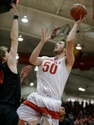 Southport center Joey Bunk (50) shoots against Terre Haute South at Southport High School in Indianapolis on March 12, 2016.