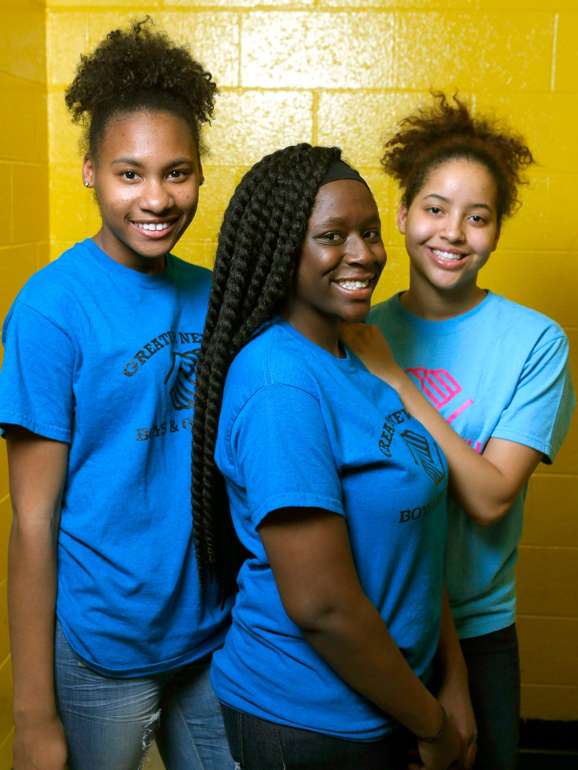 Teens (from left) J'Nea Jenkins, Brielle Braxton-Young and Karisa Phelps have formed an anti-violence effort in the wake of the beating death of a Howard High School of Technology student.