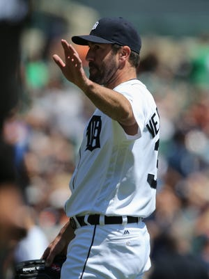 Detroit Tigers' Justin Verlander waves to fans after getting his 2,000th strikeout against  the Minnesota Twins on Wednesday, May 18, 2016 at Comerica Park in Detroit.