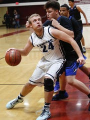 Redwood's Drew Stogsdill positions himself in the post