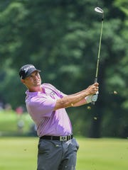Michael Arnaud hits from the 12th fairway during the