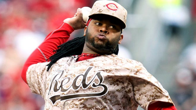 Reds pitcher Johnny Cueto only has a 7-5 record, but he leads the major leagues in innings (116) and ERA (1.86).