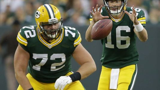 Packers center Garth Gerhart snaps to backup quarterback Scott Tolzien.