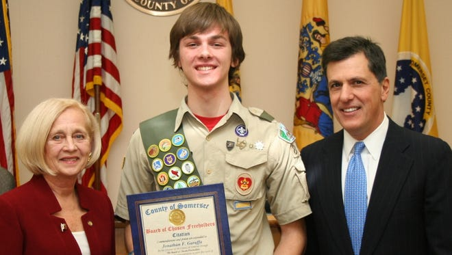Freeholder Director Patricia Walsh and Freeholder Mark Caliguire present Jonathan Garaffa of Montgomery with a citation commending him for the wooden corrals he designed and helped build for the BOBO Fridays program as part of his Eagle Scout project.