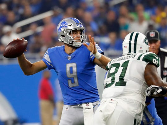 Lions quarterback Matthew Stafford throws a pass during the first half against the Jets, Saturday, Aug. 19, 2017 in Detroit.
