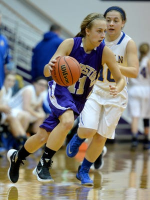 Hagerstown's Gabby Willis moves the ball against Lincoln's Hannah Hall during the 40th Annual Wayne County Basketball Tournament Saturday, Jan. 9, 2016 in Hagerstown.
