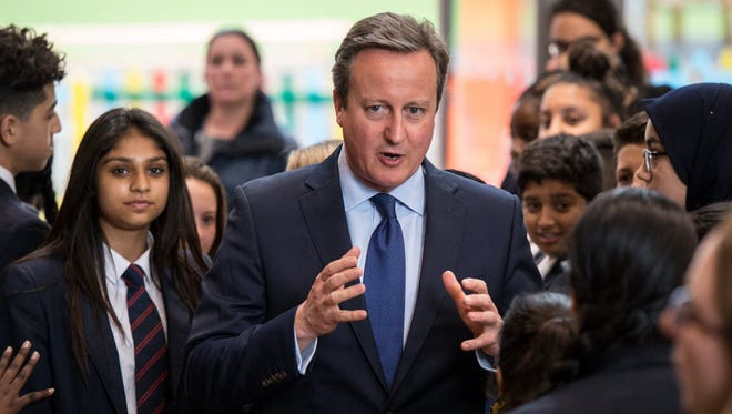 David Cameron is pictured during a visit to Reach Academy Feltham in south west London on July 12.