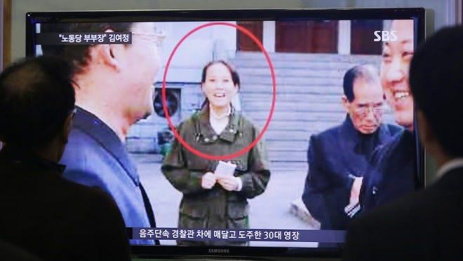 People watch a TV news program showing Kim Yo Jong, North Korean leader Kim Jong Un's younger sister, at Seoul Railway Station in Seoul, South Korea, on Nov. 27, 2014.