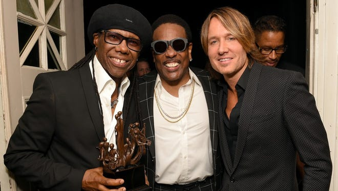 NASHVILLE, TN - MAY 31: Producer Nile Rodgers, musician Charlie Wilson and singer-songwriter Keith Urban take photos backstage during NMAAM Celebration of Legends Galaon May 31, 2018 in Nashville, Tennessee. (Photo by Jason Kempin/Getty Images for NMAAM)