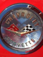 The badge on Chuck Smith's 1958 Chevrolet Corvette sparkles in the sunshine.