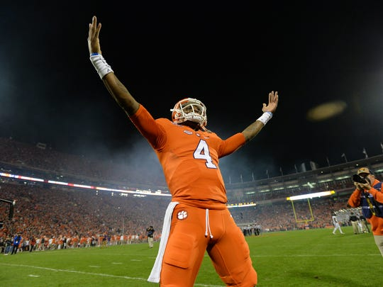 Clemson quarterback Deshaun Watson gestures to fans on the hill before the Tigers' game against South Carolina on Nov. 26, 2016, at Memorial Stadium.