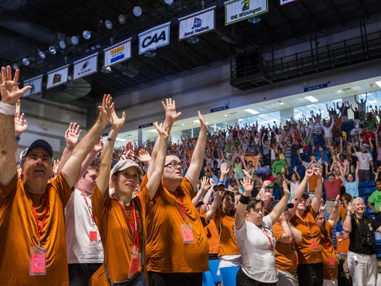 Athletes and audience members raise their arms to mimic the Special Olympics logo during the Opening Ceremonies of 2015 Special Olympics Delaware competitions at the Bob Carpenter Center in Newark on Friday afternoon.