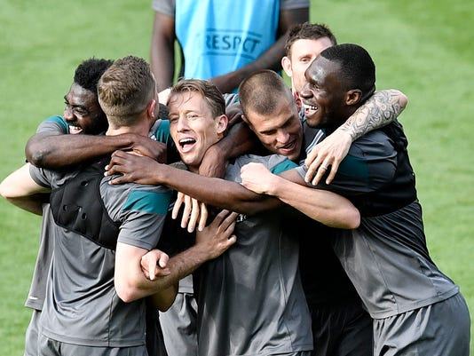 Liverpool's players have fun during the last training session prior the Europa League final between Liverpool FC and Sevilla FC in Basel, Switzerland, Tuesday, May 17, 2016. (AP Photo/Martin Meissner)