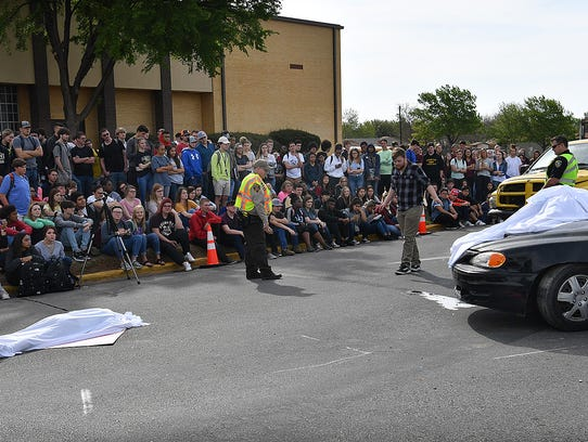 A Rider High School student talkes a field sobriety