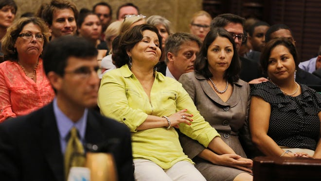 Mothers Marlene Pareto, left rear, attends court with Bertha Blanco as Blanco holds the hand of Cathy Pareto, her daughter's partner as her daughter Karla Arguello, right, looks towards her partner while their attorney makes his argument to the court.  They are one of the six same-sex couples  on Wednesday, July 2, 2014, requesting Miami-Dade Circuit Judge Sarah Zabel to rule immediately and order County Clerk Harvey Ruvin to issue them marriage licenses.  (AP Photo/The Miami Herald, Carl Juste)  MAGS OUT    M
