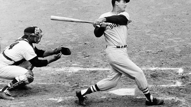 Ted Williams knocks the ball out of the park against the Washington Senators in April 1960. Months later on September 28, 1960, at Fenway Park, Williams hit a home run in the final at bat of his Hall of Fame career.
