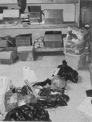 The basement of Craig Rideout's Penfield townhouse where investigators said bloody clothes were found in plastic bags and blood was found on storage bins and a wood shelf. Pictured on the floor is a Diet Coke prosecutors say may have belonged to Laura Rideout.