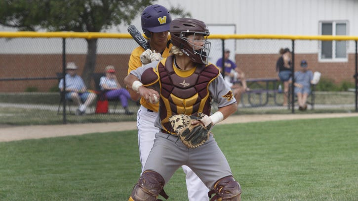 Ankeny catcher Greg Anderberg looks to make a throw to first base during the first game of a doubleheader on July 5 at Waukee. Anderberg went 2-for-4 to help the Hawks to a 3-2 victory in the opener. Waukee then won the nightcap, 9-3.