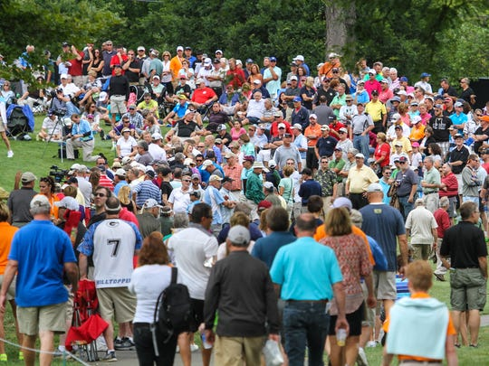 A mass of fans crowd around one of the late holes at the Dick's Sporting Goods Open on Saturday. The attendance between Friday's Zac Brown Brown and Saturday's record-breaking 59 by Kevin Sutherland has been strong.