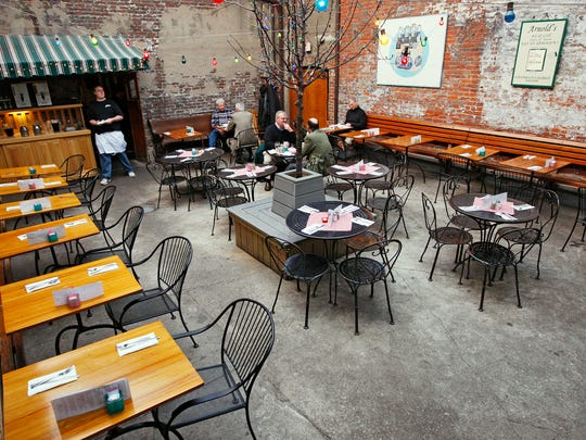 Now with a retractable roof, the Arnold's Courtyard also has bands play all summer.