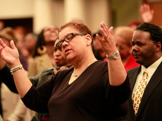 Karen Podsiadly, 47, of Rochester connects with the gospel music during the 5 a.m. Holy Week service at Mt. Olivet Baptist Church on Thursday.