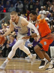 GCU's Michael Finke (42) drives against Texas Rio Grande