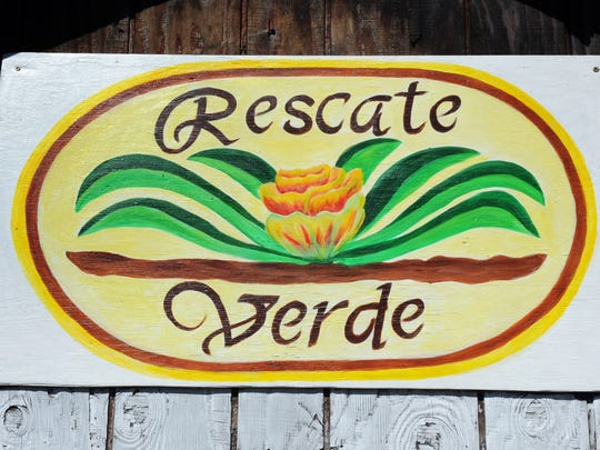 A beautiful hand-painted sign for ÒRescate VerdeÓ (Green Rescue) community garden, behind the Morelias 99c store on E. Market St. in Salinas.