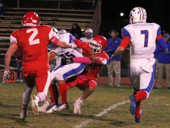 Felix Dominguez makes a tackle during action against