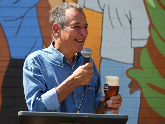 Samuel Adams founder Jim Koch gives remarks during the unveiling a mural in 2015.