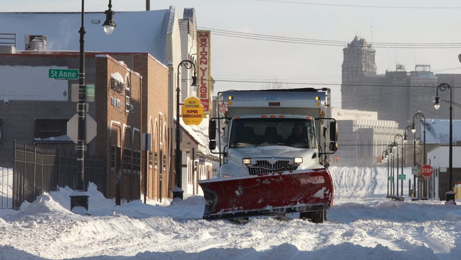 A snowplow makes it's way westbound on Bagley street in the Hubbard Richard neighborhood in Southwest Detroit after the snowstorm that hit the metropolitan Detroit area on Sunday making it one of the 3 biggest snowfalls.