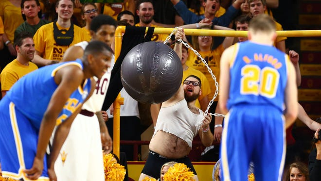 Arizona State Sun Devils fan waves a wrecking ball from behind the curtain of distraction during a second half free throw by the UCLA Bruins at Wells-Fargo Arena. The Sun Devils defeated the Bruins 68-66.