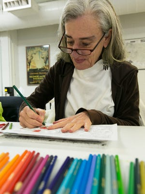 Laurie Brill colors at the Las Cruces Ladies  Coloring Club at the Las Cruces Railroad Museum on the second and fourth Fridays of each month, from 10 a.m. to noon.