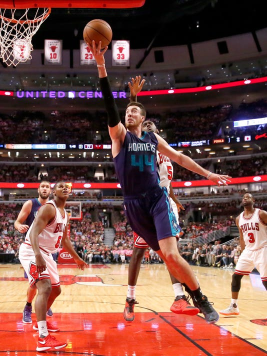 Charlotte Hornets' Frank Kaminsky III (44) scores past Chicago Bulls' Bobby Portis (5) during the second half of an NBA preseason basketball game, Monday, Oct. 17, 2016, in Chicago. The Hornets won in overtime 108-104 (AP Photo/Charles Rex Arbogast)