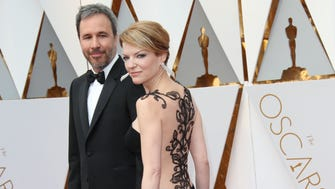 Lights! Cameras! Action!  Denis Villeneuve and Tanya Lapointe arrive on the Oscars red carpet during the 89th Academy Awards at Dolby Theatre.