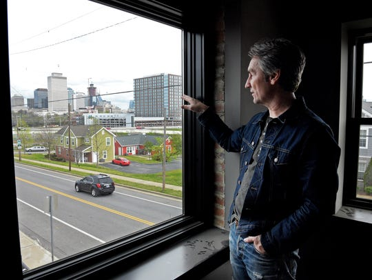 Mike Wolfe looks at downtown Nashville from a second