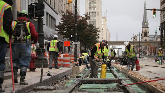 Workers prepare an area for concrete for the M-1 Rail project at Woodward and John R in Detroit. The streetcar system is expected to be operational in 2016.