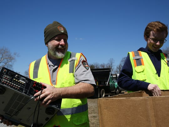 Mike Riegle of the National Park Service, left, and his son Owen load part of a computer in this photo from April 2018. They were collecting electronics to go to E-Waste.