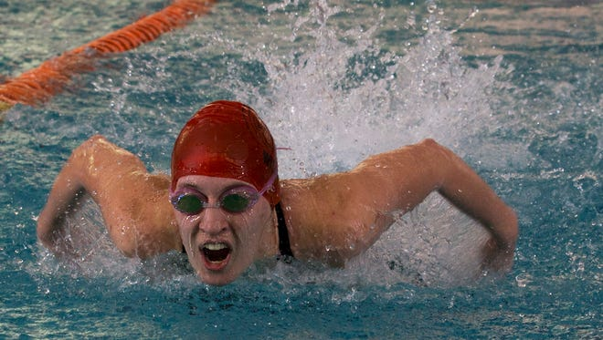 Jackson Memorial's Gabby Wilson does the butterfly leg of her team's 200 yard medley relay effort at the Ocean County Girls Swimming Championship at Ocean County YMCA in Toms River, NJ on January 15, 2016.