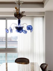 A Richard Jolley chandelier is the centerpiece residential