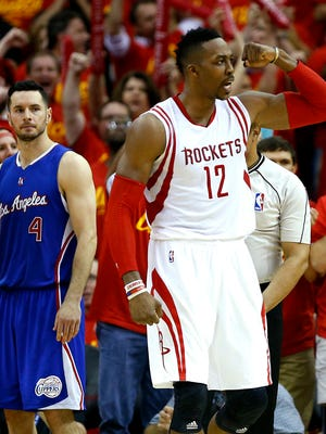 Houston Rockets center Dwight Howard (12) reacts to a play as Los Angeles Clippers guard J.J. Redick (4) looks on during the fourth quarter of Game 7 of the NBA Western Conference semifinals.