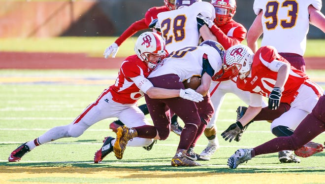 St. Philip closes the gap on defense as Deckerville tries for positive yards Saturday afternoon.
