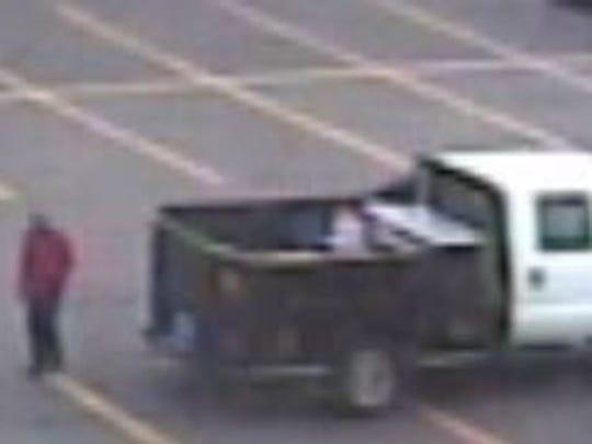 Jackson police seek public's assistance in identifying this person of interest in connection to a theft at Walmart North.