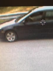 Police released this image of a dark-colored sedan in relation to the theft of nearly $500 in steaks and seafood from a grocery store in East Manchester Township.