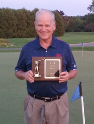 Bill Himm of Livonia proudly displays his plaque for