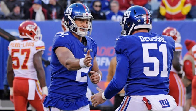 New York Giants kicker Aldrick Rosas (2) celebrates a field goal with teammate Zak DeOssie (51) during the second half Sunday against the Kansas City Chiefs.