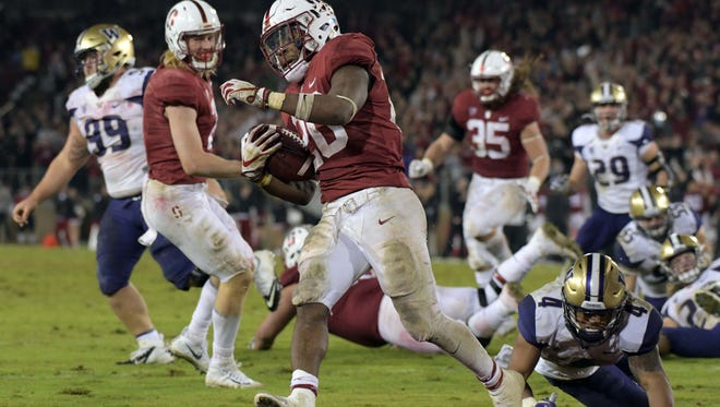 Stanford's Bryce Love (No. 20) enhanced his Heisman Trophy credentials by running for 166 yards and three touchdowns in a 30-22 victory over Washington on Nov 10, 2017 in Stanford CA.